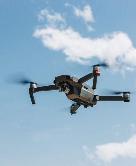 controlled-modern-drone-flying-in-blue-sky-YT84U2V